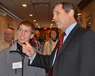 U.S. Sen. Sherrod Brown, right, speaks to OFU youth delegate Joe Schmitz of Darke County at the 80th OFU Convention.