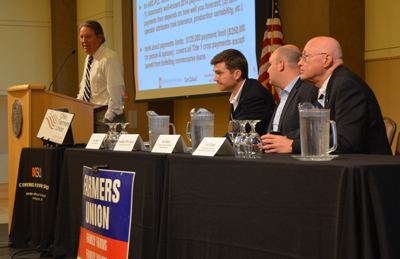 President of the Ohio Farmers Union, Joe Logan, speaks at the recent forum. Members of the first panel, (L-R) include Jonathan McCracken, aide to U.S. Sen. Sherrod Brown; Joe Schulz, chief economist, U.S. Senate Ag Committee; and Carl Zulauf, professor at Ohio State University.
