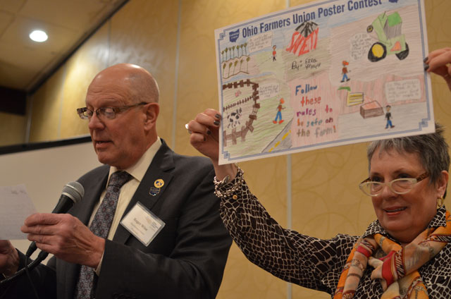 Roger and Sandra Wise teamed up last year to announce award winners in the 2014 Poster Contest.